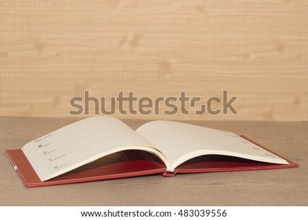 book  is open on wooden desk