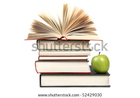 book stack with apple isolated on white background - stock photo