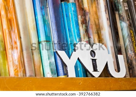 books on a bookshelf in the library - stock photo