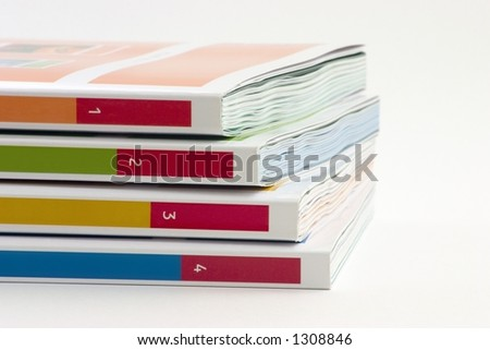 4 books on a white background - stock photo