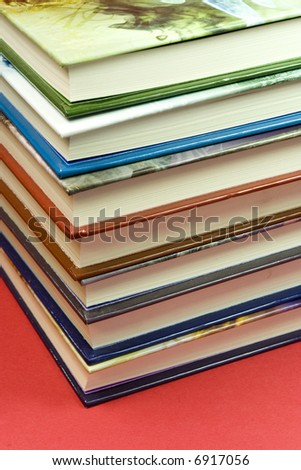 7 books on stack in red background - stock photo