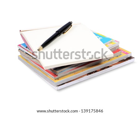 books stack with pen isolated on white background - stock photo