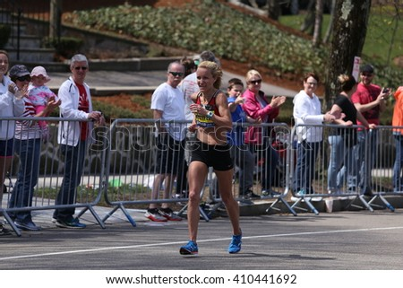 BOSTON - APRIL 18: Laurie Knowles races with the elite women  up Heartbreak Hill during the Boston Marathon April 18, 2016 in Boston. [public race]