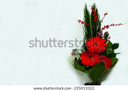 Bouquet with Daisy flower red gerbera and green leaves - stock photo