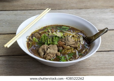 bowl of noodles on wooden table. delicious noodle. Instant noodle - stock photo