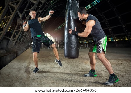 boxer practicing with trainer  - stock photo