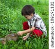Boy fed rabbits in the garden by hand - stock photo