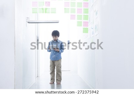 Boy looking at something on tablet