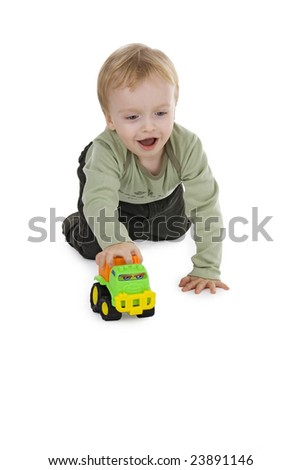 Boy playing with toy - car on white background