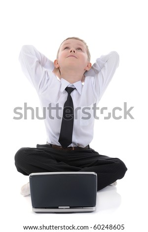boy with a laptop sitting on the floor. Isolated on white background - stock photo