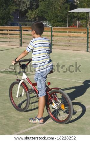 boy with bike outdoor - stock photo