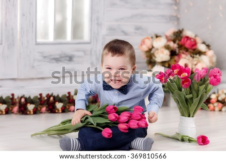 boy with tulips. March 8, International Women's Day, Mother's Day - stock photo