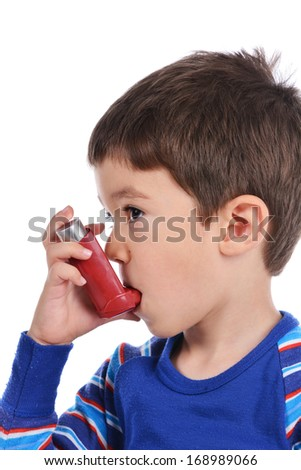 Boy 4 years old inhales himself on a white background
