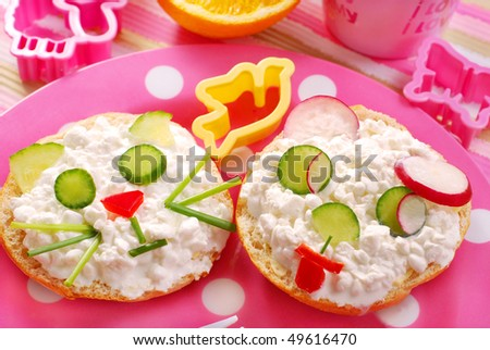 breakfast for child with cat and dog shape sandwich - stock photo