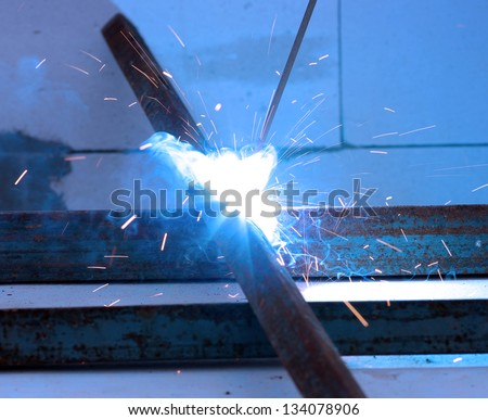 Bright electric arc and sparks - stock photo