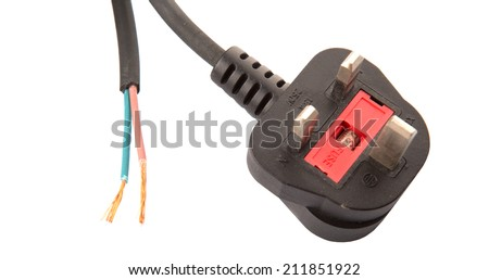 British Standard three pin AC power plugs and exposed electrical wire over white background - stock photo