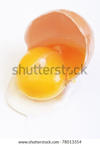 Broken brown egg on a white background.