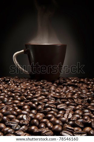 brown cup of coffee with beans over gradient background - stock photo