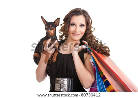 brunette posh girl with miniature pinscher,  carrying shopping bags and wearing stylish fashion clothes - stock photo