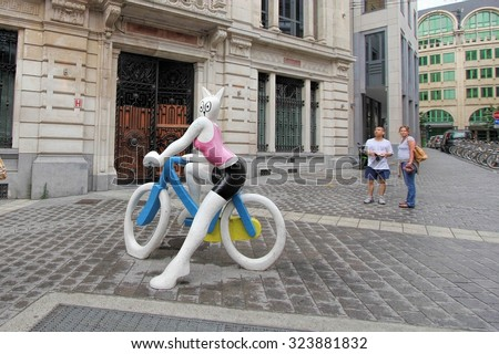BRUSSELS, BELGIUM- JUNE 10 ,2011: one of the comic statutes in Brussels, known as a homeland of comic strips and is full of comic murals - stock photo