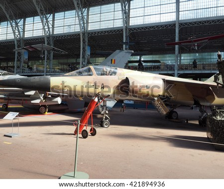 BRUSSELS-OCT. 10: An AMD BD Mirage F1C military jet fighter plane is seen in The Royal Museum of Armed Forces and Military History in Cinquantenaire Park in Brussels, Belgium on Oct. 10, 2015.    - stock photo