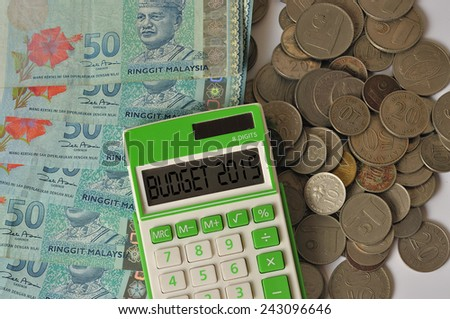 """BUDGET 2015"" On Green Calculator With Coin and Malaysia Bank Notes - stock photo"