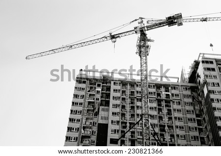Building and cranes under construction /  Building and cranes  - stock photo