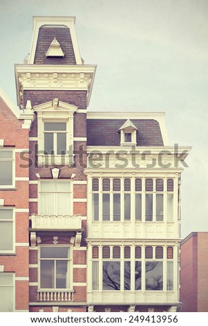 1887 building in Amsteldijk, Amsterdam, the Netherlands, facade. Toned textured image in a retro nostalgic style.  - stock photo