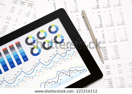 Business charts and diagrams on digital tablet. - stock photo