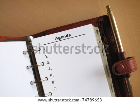 Business concepts Agenda list with numbers in a personal organizer - stock photo