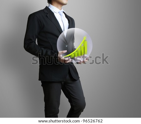 business graph in hand - stock photo