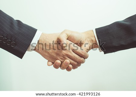 Business man handshake and business people. handshake on white background. Shake hands after their meeting. vintage tone. - stock photo
