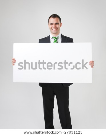 business man holding big white card - stock photo