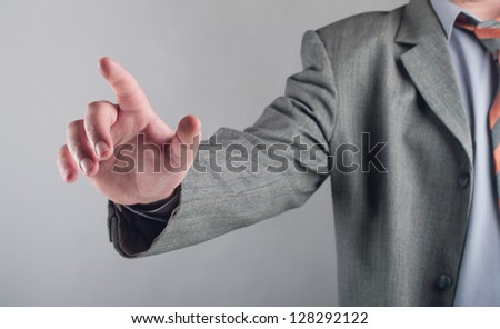 business man pushing an imaginary button - stock photo