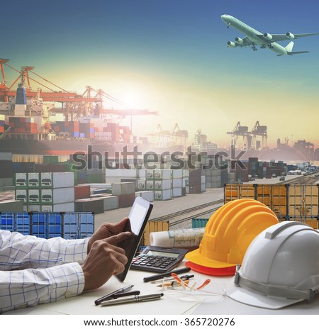 business man working table in container dock use for logistic industry and import export , freight cargo shipping theme - stock photo