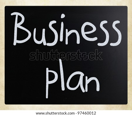 """Business plan"" handwritten with white chalk on a blackboard"