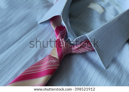 business shirt and pink coiled necktie - stock photo
