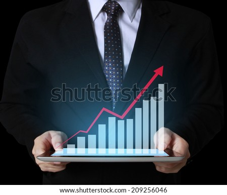 business team using tablet computer to work with financial data  - stock photo