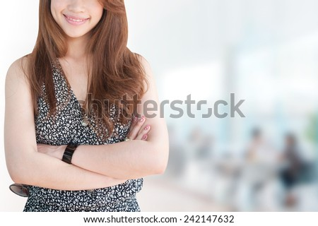 business woman in her office.Mixed Asian / Caucasian businesswoman.