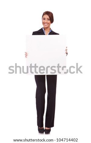 business woman standing behind  a blank board on white background - stock photo