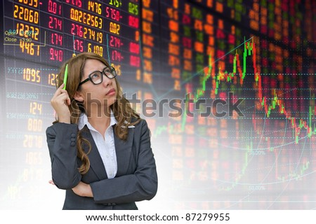 business woman thinking in stock exchange board - stock photo
