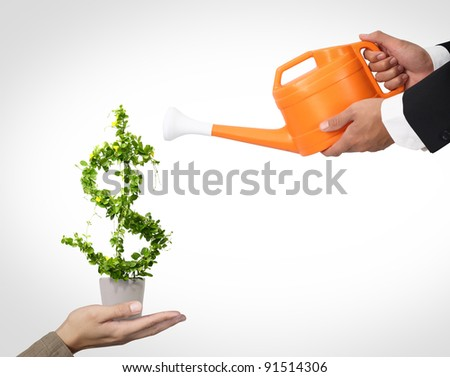 2 Businessman and watering pot - stock photo
