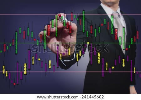 businessman drawing a stock  graph  - stock photo