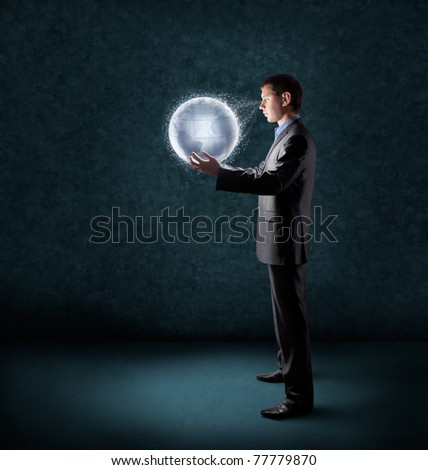 businessman holding glowing planet earth - stock photo