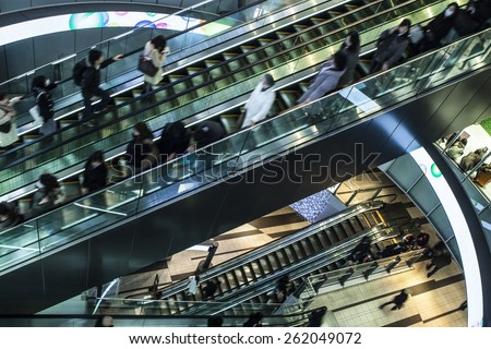 Businessmen to move the escalator in the office above high Angle view - stock photo