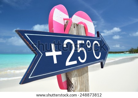 +25C arrow on the beach - stock photo
