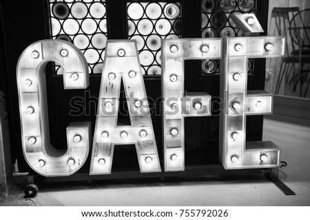 """Cafe"""" Vintage sign made with wooden letters with lamps texture. Bar cafe caffe restaurant office shop warehouse sign background. Retro style. Vintage effect."