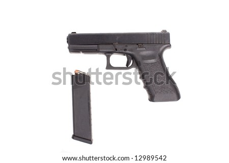 .40 caliber handgun isolated on white background with magazine full of hollow point bullets next to it