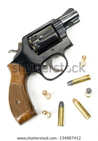38 Caliber Revolver Pistol Loaded Cylinder Gun Barrel Close Up Pointed on White - stock photo