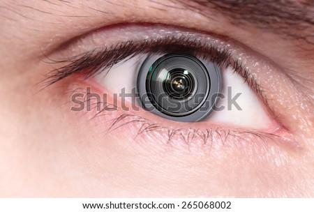 Camera lens inside the eye - stock photo